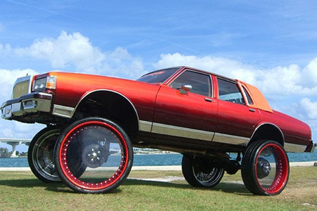 i could be wrong here, but sick rims might just be the answer.